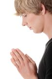 Young caucasian man praying Royalty Free Stock Images