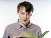 Young caucasian man reading book Royalty Free Stock Photos