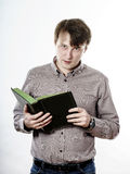 Young caucasian man reading book Royalty Free Stock Images