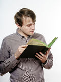 Young caucasian man reading book Stock Photography