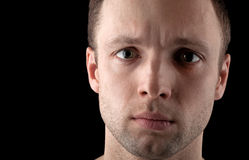 Young Caucasian man's portrait on black Royalty Free Stock Image