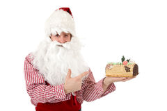Young caucasian man Santa Claus, cake Royalty Free Stock Photography