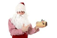 Young caucasian man Santa Claus, cake royalty free stock photography