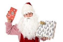Young caucasian man Santa Claus, gifts royalty free stock photo
