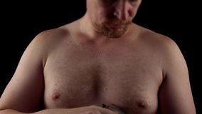 Man shaves his chest