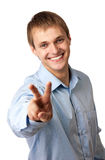 Young Caucasian man showing a peace sign Royalty Free Stock Photos