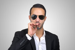 Young Caucasian man smoking cigar Stock Images