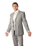 Young Caucasian man in a suit looking amazed. Over white background Royalty Free Stock Photo