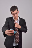 Young caucasian man in suit using asthma inhaler to handle pr Royalty Free Stock Photos