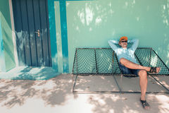 Young caucasian man swinging in a hammock pleasant laziness of weekend morning. Stock Photo