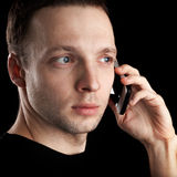 Young Caucasian man talks on mobile phone Royalty Free Stock Photo