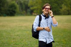 Young Caucasian Man Using Phone Outdoor. stock photo