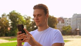 Fair haired guy chatting use phone stock video