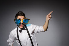 The young caucasian man wearing sunglasses against Royalty Free Stock Images