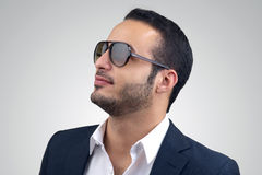 Young Caucasian man wearing sunglasses posing Stock Photo