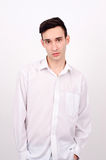 Young Caucasian man in white shirt. Royalty Free Stock Image