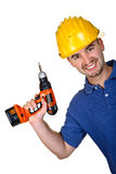 Young caucasian manual worker with  drill. Background Royalty Free Stock Photo