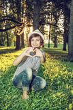 Young caucasian natural woman making heart shape, retro photo fi Royalty Free Stock Images