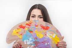 Young Caucasian painter. Young Caucasian girl laughing with palette Stock Photography