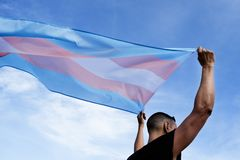 Young person with a transgender pride flag stock photos