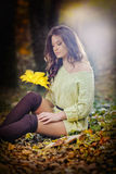 Young Caucasian sensual woman in a romantic autumn scenery. Fall lady .Fashion portrait of a beautiful young woman in forest. Young Caucasian sensual woman in a Stock Photos