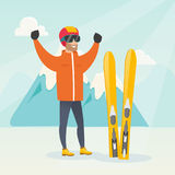 Young caucasian skier standing with raised hands. Caucasian skier standing with raised hands on the background of snowy mountains. Young cheerful skier resting Stock Photography