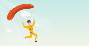 Young caucasian skydiver flying with a parachute. Stock Photo