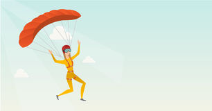 Young caucasian skydiver flying with a parachute. Stock Image