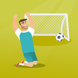 Young caucasian soccer player celebrating a goal. Happy caucasian soccer player celebrating a goal. Young football player kneeling with raised arms on the Stock Photography