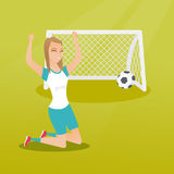 Young caucasian soccer player celebrating a goal. Happy caucasian soccer player celebrating a goal. Young football player kneeling with raised arms on the Stock Photos