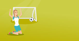 Young caucasian soccer player celebrating a goal. Happy caucasian soccer player celebrating a goal. Young football player kneeling with raised arms on the Royalty Free Stock Photography