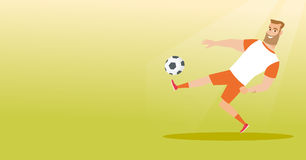 Young caucasian soccer player kicking a ball. Young caucasian soccer player kicking a ball during game. Soccer player juggling with a ball. Sportsman playing Royalty Free Stock Photography