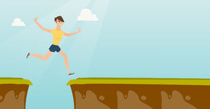 Young caucasian sportswoman jumping over the cliff. Smiling woman jumping across the gap from one rock to another. Young caucasian sportswoman jumping over rocks Royalty Free Stock Image
