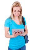 Young caucasian student  girl using a tactile tablet Royalty Free Stock Photo