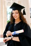 Young caucasian student in gown with watch Stock Image