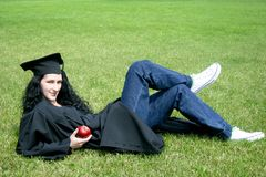 Young caucasian student laying on the grass Royalty Free Stock Photography