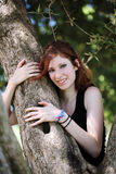 Young caucasian teen girl in tree smiling Stock Photo