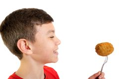 Young caucasian teenage boy with a scotch egg. Young caucasian teenage boy eating a scotch egg Royalty Free Stock Image