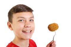 Young caucasian teenage boy with a scotch egg. Young caucasian teenage boy eating a scotch egg Stock Photos