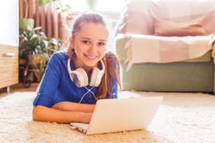 Young caucasian teenage girl having fun use laptop Royalty Free Stock Images