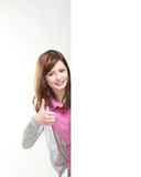 A young Caucasian teenage girl holding thumbs up Royalty Free Stock Images