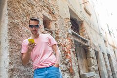 Young caucasian man with cell phone in european city Stock Photos