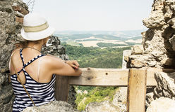 Young caucasian tourist woman in a sailor outfit on the ruins of Royalty Free Stock Photo