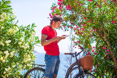 Young caucasian traveling man reading a map Royalty Free Stock Photo