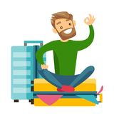 Young caucasian white man sitting on suitcase. Young caucasian white man sitting on a suitcase full of clothes and trying to close it. Happy man packing a lot Stock Photography