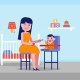 Young caucasian white mother feeding her baby. Royalty Free Stock Images