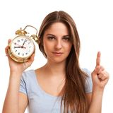 Young caucasian woman with alarm clock Royalty Free Stock Images