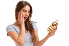 Young caucasian woman with alarm clock Royalty Free Stock Image