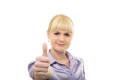 Young woman raises thumb up Stock Photo
