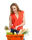Young caucasian woman with assorted grocery products in shopping Royalty Free Stock Photography